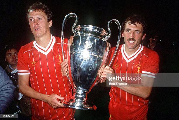 30th MAY 1984, European Cup Final, Rome, Italy, Liverpool 1 v Roma 1, , Liverpool's Phil Neal and Alan Kennedy hold the European Cup trophy after...