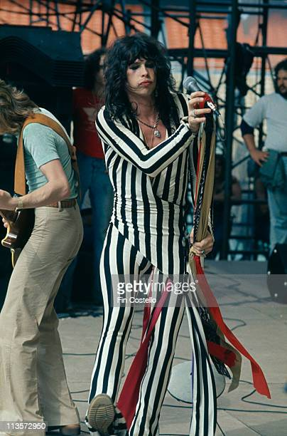 30th MAY: Singer Steven Tyler, of American rock group Aerosmith, on stage at the RFK Stadium in Washington D.C. On 30th May 1976. On the left is...