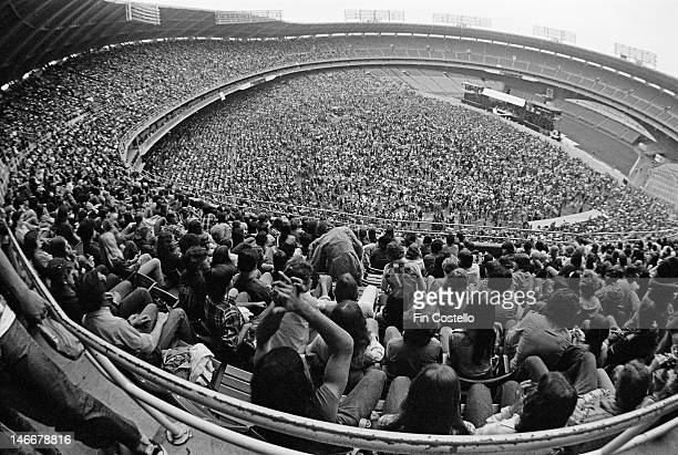 View of music fans at RFK Stadium in Washington DC USA watching a concert by American rock band Aerosmith on 30th May 1976