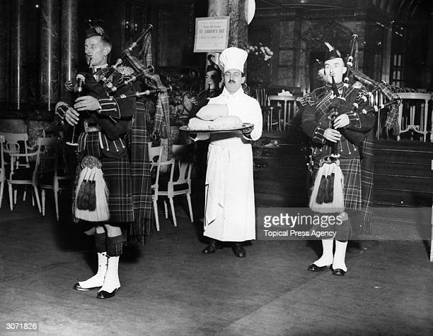 Scotch haggis and pipers at the Savoy Hotel on the feast day of St Andrew the patron saint of Scotland