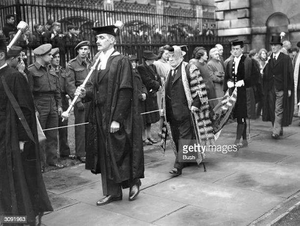 British statesman Earl Stanley Baldwin at Senate House, Cambridge, wearing a ceremonial cap and gown.