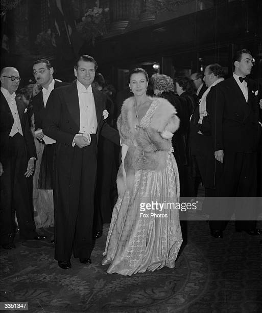 English actor Laurence Olivier and his wife Vivien Leigh arriving at the Empire Theatre, London, for the Royal Command Film Performance of 'Scott of...