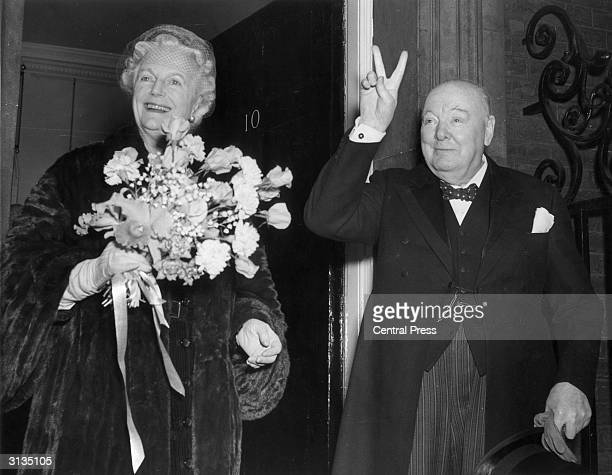 British Conservative politician Winston Churchill and his wife Clementine outside number ten Downing Street London on his 80th birthday