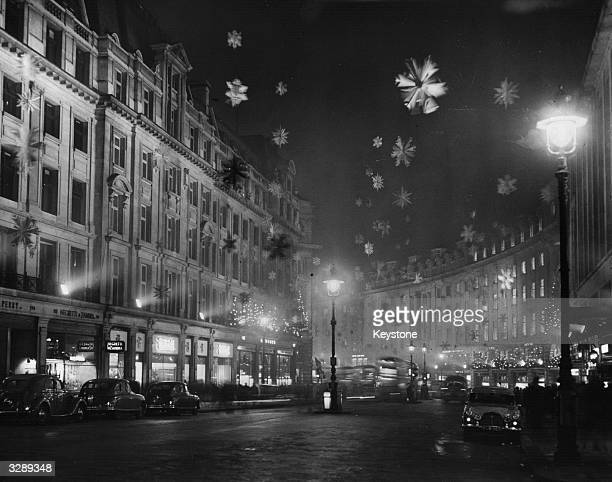 Christmas decorations in Regent Street London consisting mainly of snow crystal stars made of aluminium to give the effect of a snowstorm