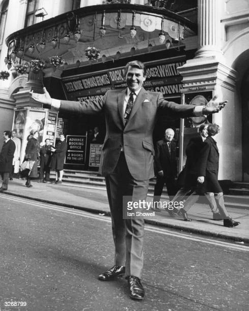 Star pianist Russ Conway outside the London Palladium, where he is appearing in a pre-panto variety package show with other stars. It will be...