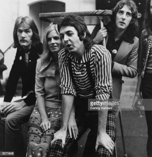 Paul and Linda McCartney with members of their pop group Wings