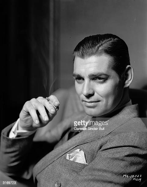 American actor Clark Gable smoking a cigarette Known as the King of Hollywood he died two days after finishing filming on 'The Misfits'