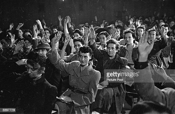 Women workers vote to forge links with the women workers of the Soviet Union, after an address by Ernest Bevin. Original Publication: Picture Post -...