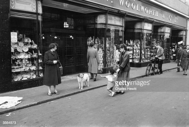 Passersby in front of Woolworth's store in Brixton south London In the centre is Mrs Babs Sango a British woman married to a Johnnie West Indian...