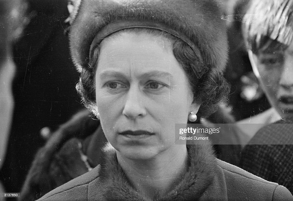 Queen Elizabeth II visits Aberfan in Wales, a few days after a coal tip collapsed on the local school, killing 141 children and four adults.