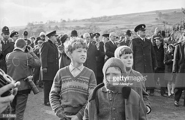 Three children stand out from the crowds during Queen Elizabeth II's visit to Aberfan in Wales A few days earlier a coal tip had collapsed on the...