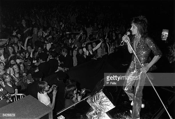 Rod Stewart singing at a Faces concert during a music festival at Wembley Stadium London