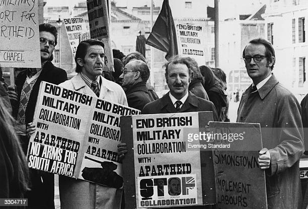Dennis Skinner MP joins an anti-apartheid demonstration. The placards read - 'End British Military Collaboration With Apartheid'.