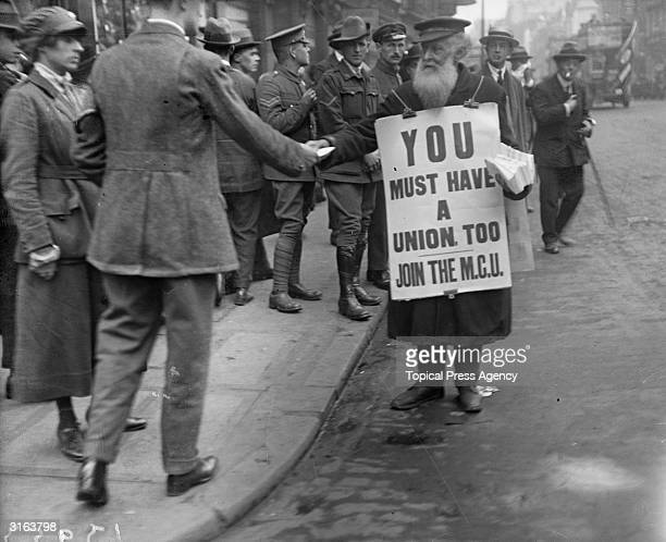A sandwichman in the Strand London recruiting members for the MCU during the railway strike