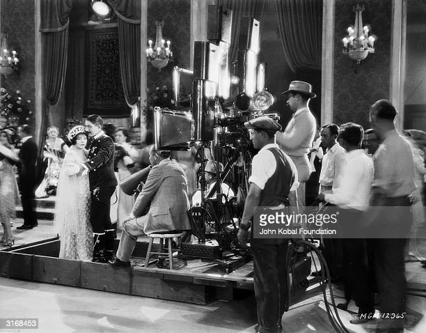 The director and crew filming a ballroom scene from Renee Adoree's latest film Formally known as Jeanne de la Fonte she performed as a circus...