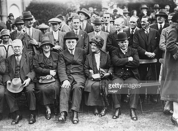 British politician George Lansbury poses in a group photo with his wife at a Labour party conference in Brighton
