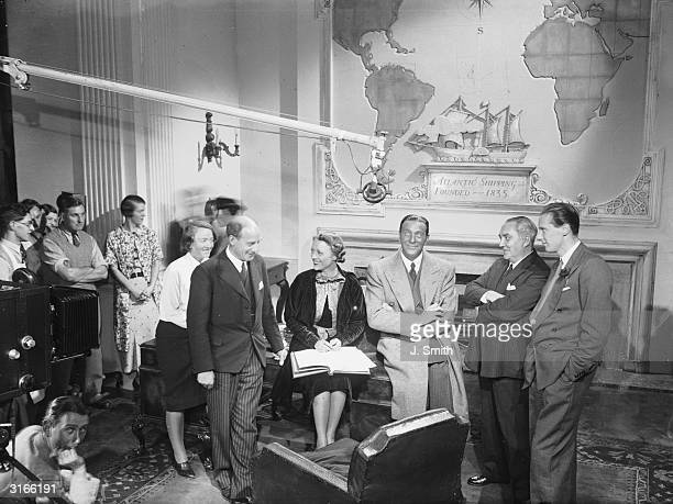 Film stars Sally Eilers and Ricardo Cortez with Dr Leslie Burgin and producer Jack Raymond and director Carol Reed at the opening of Pinewood Studios...