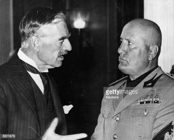 British prime minister Neville Chamberlain talks to Italian premier Benito Mussolini during the Munich Conference