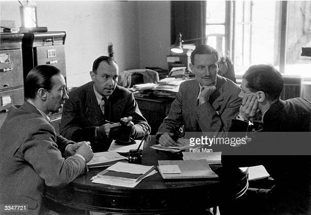 British actors Ralph Richardson Laurence Olivier and producer Tyrone Guthrie talk with playwright John Burrell Original Publication Picture Post 1812...