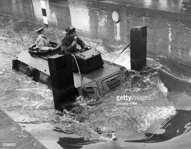 A sealed Armoured Carrier for personnel in Armoured Armoured Car Regiments and Divisional Engineer units being demonstrated in six feet of water at...