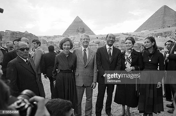 3/10/1979Cairo Egypt President and Mrs Carter pose with President Anwar Sadat in front of the Shpinx and a pyramid during a tour of this historic...
