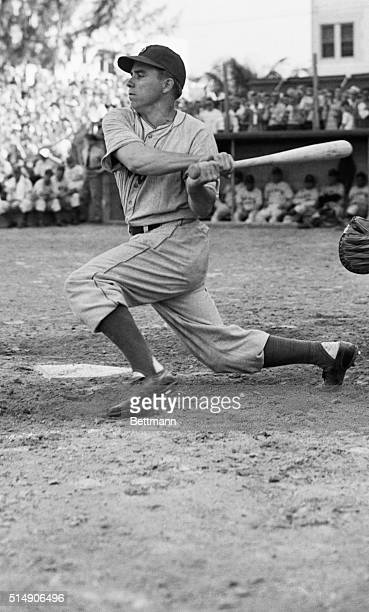 3/11/1946Miami FL Pee Wee Reese back at his post in the Brooklyn Dodgers' infield takes a hard cut at the ball in the fifth inning of a preseason...