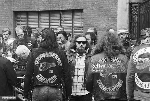 3/11/1971New York New York Sporting their long hair and dirty denim jackets members of the Hell's Angels motorcycle gang gather behind the hearse on...