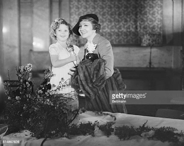 3/1/1935Los Angeles CA Shirley Temple child star and Claudette Colbert film luminary with their awards presented them by the Academy of Motion...