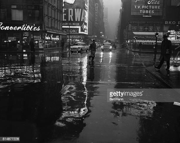 It was high noon when this scene was made looking East on 47th Street and Broadway but only the folks with waterproof wrist watches could tell it...