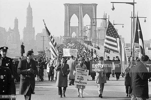 Puerto Rican demonstrators walk in silence from City Hallin Mahattan across the Broklyn Bridge to the Board of Education Offices in Brooklyn during...
