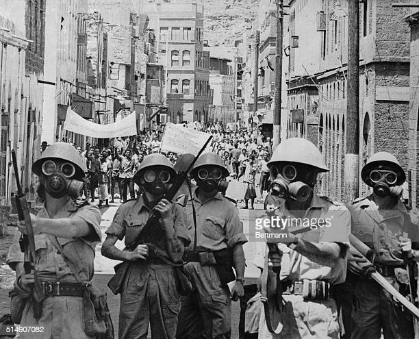 3/1/1967Aden Wearing gas masks British troops move through the streets of Aden dispersing demonstrators with tear gas The troops were ordered into...