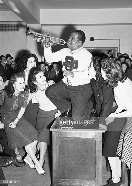 3/12/1941New York NY Louis Armstrong world famous trumpet player gleefully accepts a doctor of swing degree awarded to him by Brooklyn college He...
