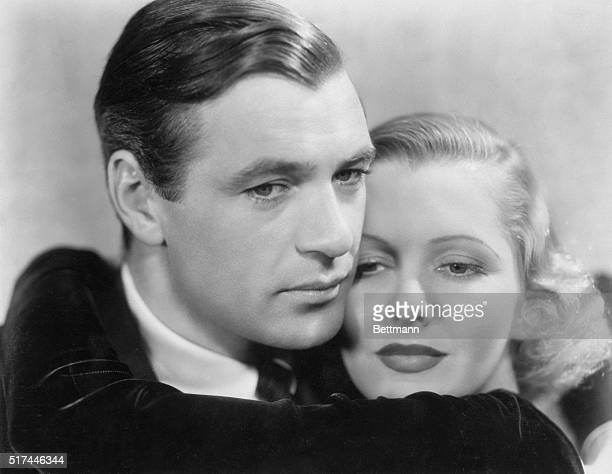 3/13/1936Gary Cooper and Jean Arthur embrace for a closeup photograph