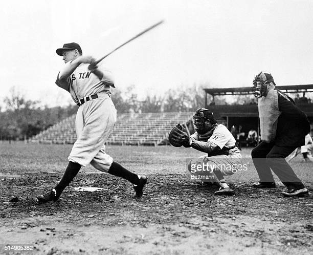 Orlando, FL: Joe Cronin, Manager of the Boston Red Sox, pops out to first in the opening inning of the Washington-Red Sox training camp exhibition...