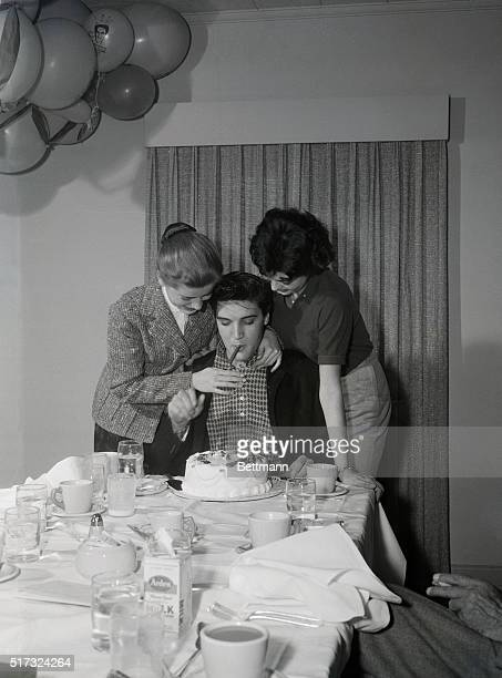 """Hollywood, CA: Army-bound rock 'n roll celebrity Elvis Presley is the center of attention at a going-away party given by cast and crew of """"Kid..."""