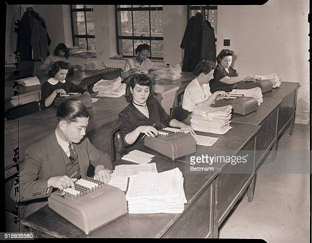 3/14/1944New York NYHere are a few operators out of the batteries of workers who check your tax form with calculating machines There's no cheating on...