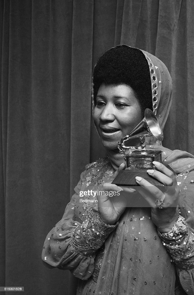 New York, NY-Portrait of Aretha 'Lady Soul' Franklin holding her Grammy for 'Best Rhythm and Blues Female Perfomer,' at Madison Square Garden in New York.