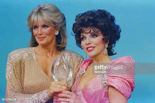 3/14/1985Peoples Choice Awards in Hollywood Joan Collins with Linda Evans Angela Lansbury Emmanuel Lewis Lewis with Deirdre Hall Phylicia AyersAllen...