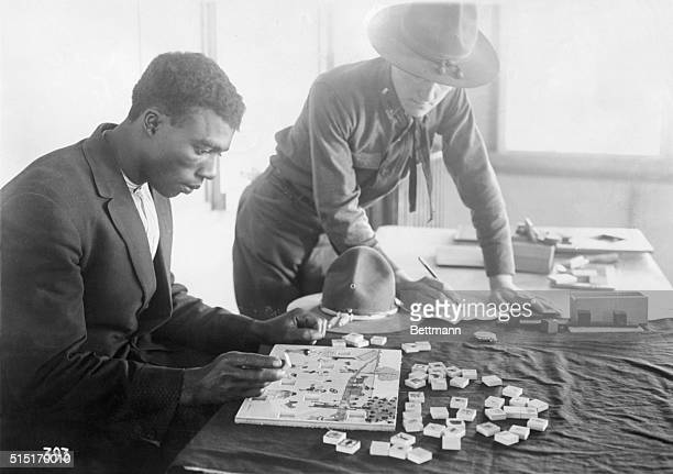 3/15/1918An Army recruiting officer testing the mentality of a Negro applicant by means of cutout blocks