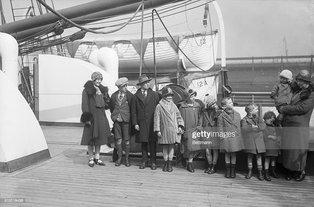 New York-Photo shows Mrs. Thomas McKessy, of Limerick, Ireland, upon her arrival in New York on the SS Aurania. She is joining her husband, who came over last September, with 10 of her family of 21 children. Pictured (L-R) are Johanna, John, Dennis, Lizzie, Katherine, Bridget, Eugene, Donald, Ita, and Mrs. McKessy holding Cecilia the youngest in her arms. Of her 21 children, 4 are here already, 10 just arrived, 5 died and two are married in Ireland.