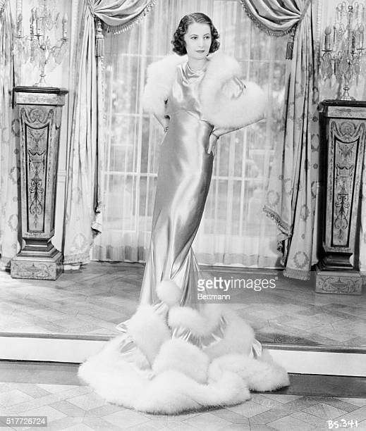 3/16/1934Wearing this gorgeous silver gown trimmed with white Maribou Brabara Stanwyck is taking no gamble in charm when she appears in her...