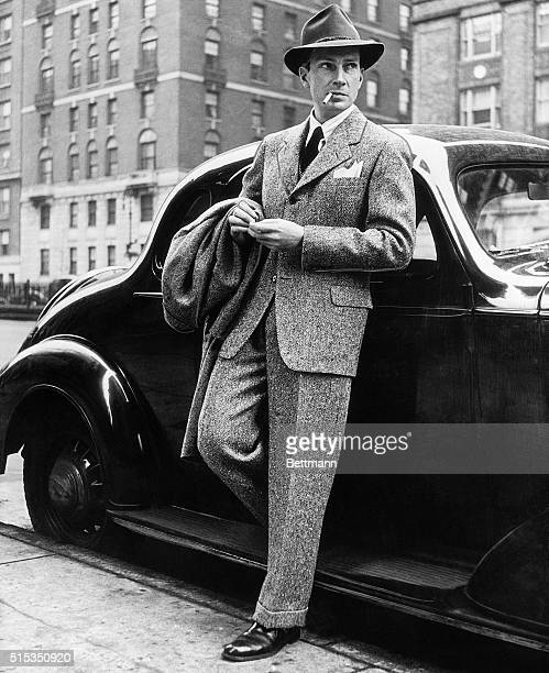 Mid-way between the strictly business suit and active sports togs is the three-button single-breasted country lounge model of nubby wool tweed as...