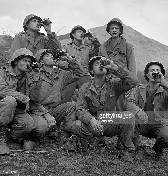 3/16/1944Cassino Front Italy Distribution of the first bottles of Coca Cola to reach our fighting men in Italy calls for celebration as these members...