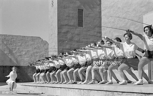 3/17/1935Alameda CA Helene Meyer Olympic fencing champion is teaching the art of fencing to 28 girls on the fencing team of the fashionable Mills...