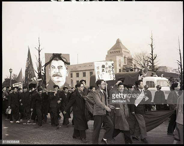 3/17/1953Tokyo JapanLeft wing Japanese trade union members in Tokyo are shown parading past Japan's parliament building with a huge portrait of the...