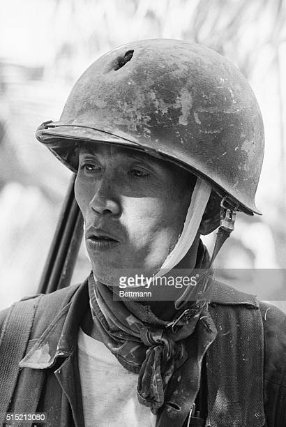 3/17/1965Vinh Long South Vietnam A wounded South Vietnamese ranger waits his turn to be treated in a field aid station The hole in his helmet was...