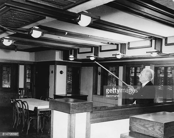 3/18/57Chicago Illinois Renowned architect Frank Lloyd Wright points out features of Robie House here March 18th after arriving to try and save the...