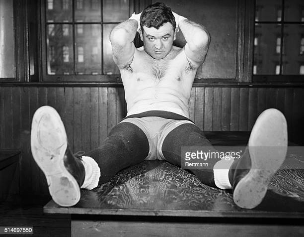 3/19/1941New York NY James J Braddock former world's heavyweight boxing champion is shown exercising his stomach and neck muscles at Stillman's Gym...