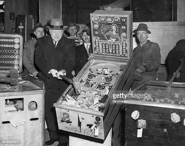 3/19/1949New York NY Catching bandits comes under the heading of police department business but here's the New York Police Commissioner himself...