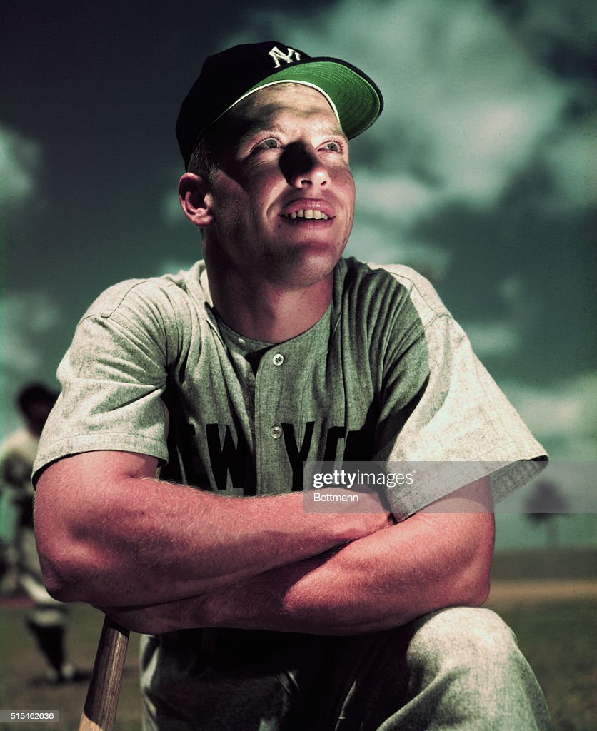Mickey Mantle in his New York Yankees baseball uniform. He is shown here from the waist-up and smiling. INP color slide.